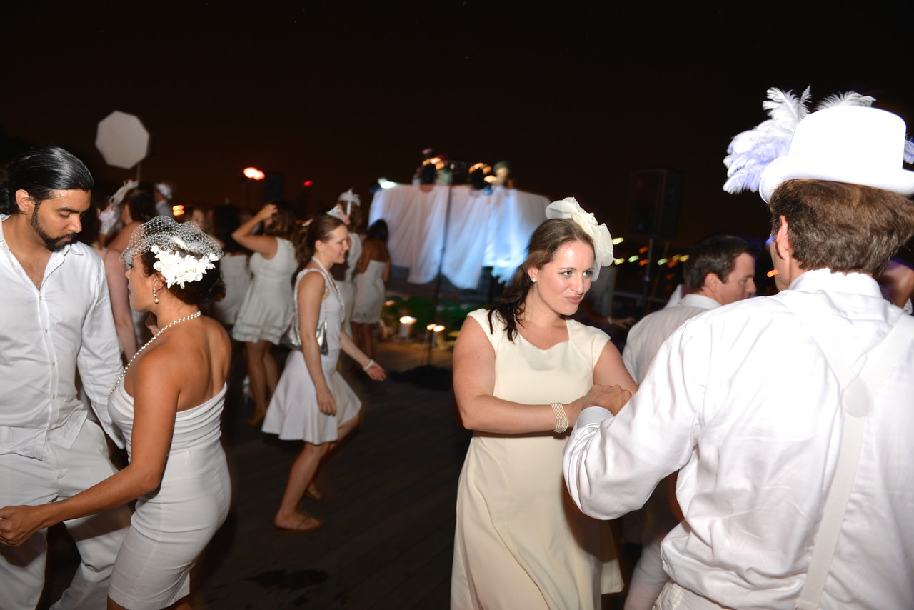 Alison Marriott, The global phenomenon secret dinner party, Diner en Blanc, attracted over 1,300 guests all wearing white.  The Yards Park, Thursday, September 4, 2014.  Photo by Ben Droz