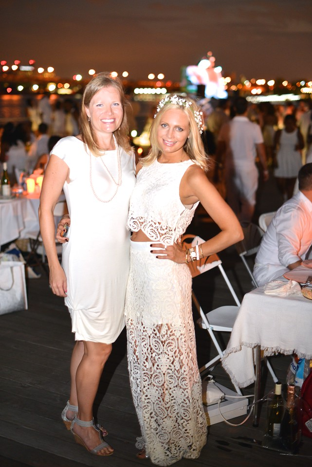 Kate Scavello, Jeanne Shewmaker, The global phenomenon secret dinner party, Diner en Blanc, attracted over 1,300 guests all wearing white.  The Yards Park, Thursday, September 4, 2014.  Photo by Ben Droz