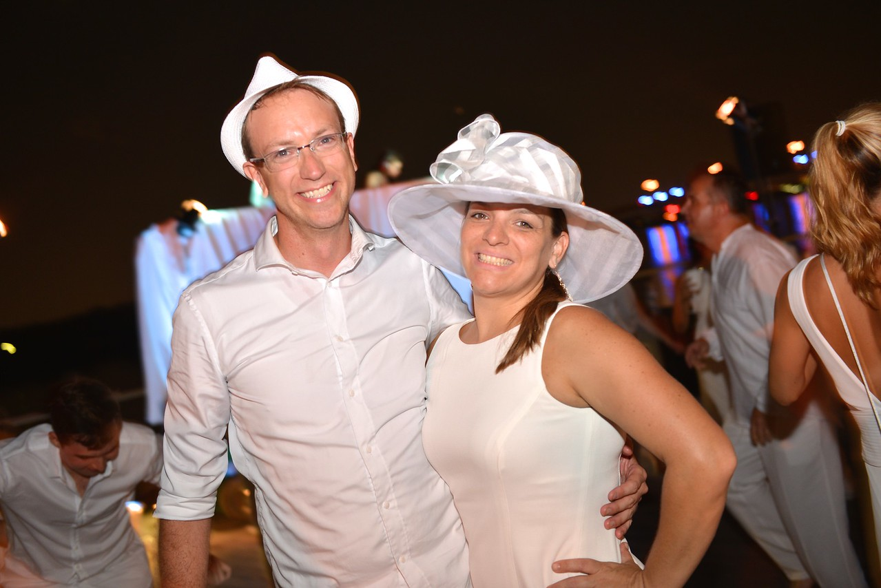 Anthony Hesselius, Jackie Ludden, The global phenomenon secret dinner party, Diner en Blanc, attracted over 1,300 guests all wearing white.  The Yards Park, Thursday, September 4, 2014.  Photo by Ben Droz