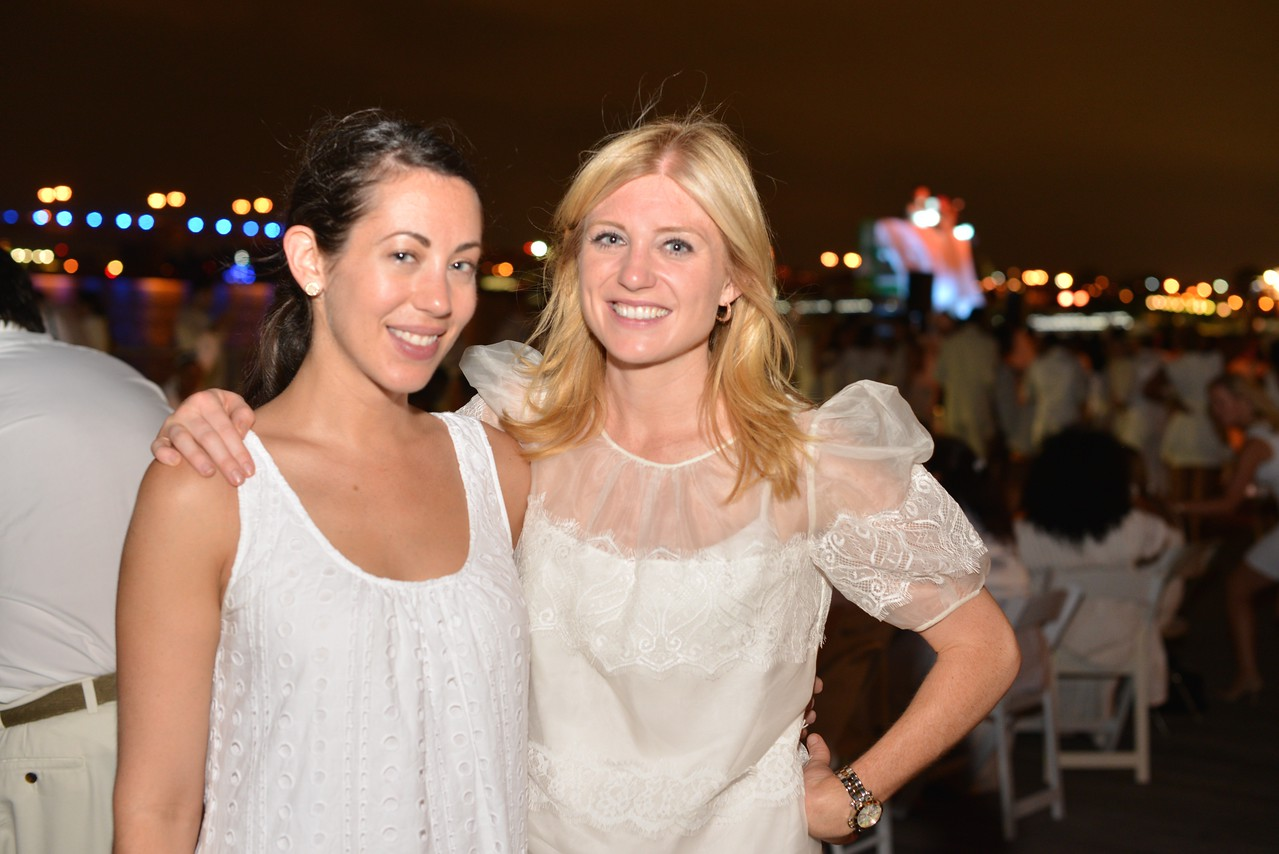 Rachel Cothran, Erin McPike, The global phenomenon secret dinner party, Diner en Blanc, attracted over 1,300 guests all wearing white.  The Yards Park, Thursday, September 4, 2014.  Photo by Ben Droz