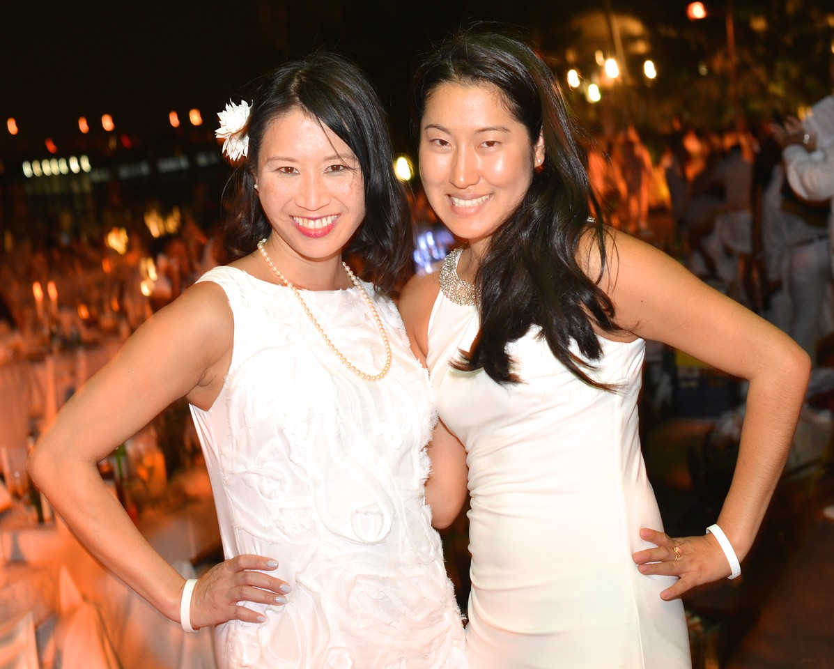 Lacey Chong, Hailey Choi, The global phenomenon secret dinner party, Diner en Blanc, attracted over 1,300 guests all wearing white.  The Yards Park, Thursday, September 4, 2014.  Photo by Ben Droz