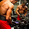 Tony DiCosta at Health & Strength Gym re-racking weights