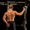 Adam Krouse doing one armed lat pulldowns with cables