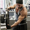 Tony DiCosta at Health & Strength Gym un-racking weights