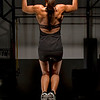 Lindsay Bloom doing wide gripped pull ups