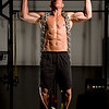 Dr. John Rusin doing wide gripped pull ups with chains