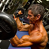 Tony DiCosta at Health & Strength Gym doing preacher curls