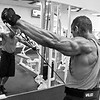 Tony DiCosta at Health & Strength Gym doing lateral raises