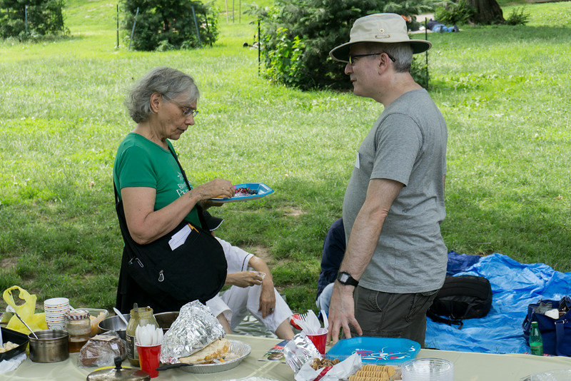 Charlotte Phillips, Chair of Brooklyn For Peace, chats with Ricky Blum at the Pot Luck Picnic.