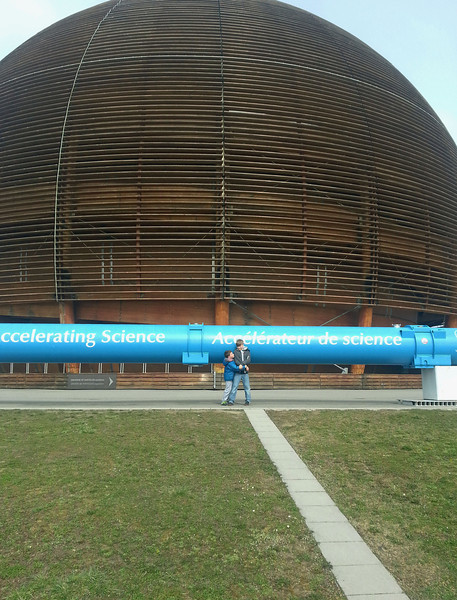 Tao and Noa at the visitor's exhibit at CERN, the European Nuclear Research Center. That blue thing is an accelerator and they pretended to be two particles accelerating and then crashing into each other, just like experimental physics that found the Higgs Boson.