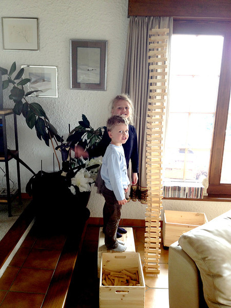 Eliott and Charlotte with a tower made of Kapla blocks at their Grandma's place in Nendaz.