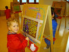 Eliott painting. Is this at the creche? In any case, he finished the creche in July and is now in kindergarten.
