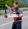 A BMC soigneur has more than just feed-bags - he has two pizzas for some lucky riders..!