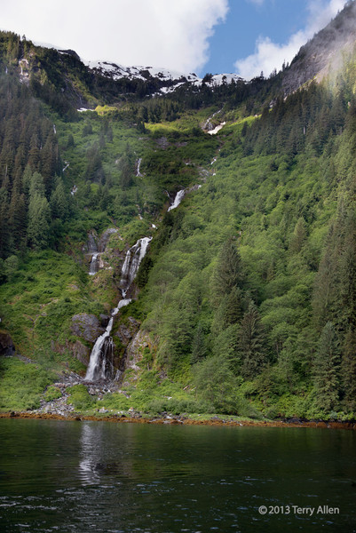 Long waterfall coming down an avalanche slope at the head of Khutze Inlet, Great Bear Rainforest, BC