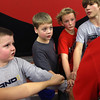 11-28-12<br /> Parisi Speed School at Club Fitness 24<br /> The boys put their hands in after a workout during the Parisi Speed School at Club Fitness 24.<br /> KT photo | Kelly Lafferty
