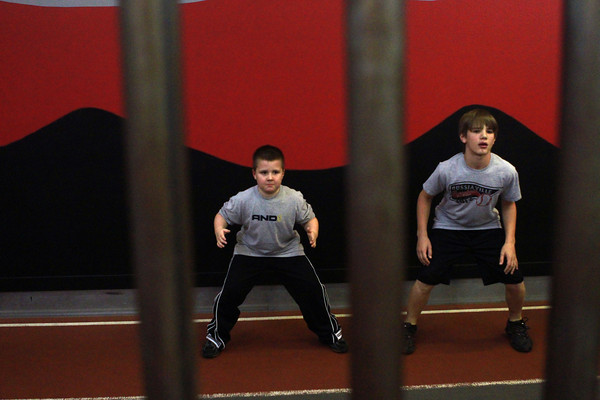 11-28-12<br /> Parisi Speed School at Club Fitness 24<br /> Talon Morgan and Kitchel Gifford do a leg exercise during the Parisi Speed School at Club Fitness 24.<br /> KT photo | Kelly Lafferty