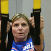 11-15-12<br /> Heartland-TRX class<br /> Theresa Barlow concentrates as she works out during a TRX class at Kokomo's YMCA.<br /> KT photo | Kelly Lafferty
