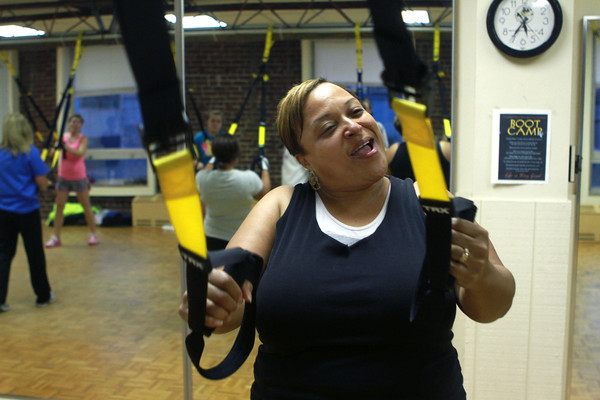 11-15-12<br /> Heartland-TRX class<br /> Cheryl Sutton feels the burn during one of the exercises of the TRX class at the YMCA.<br /> KT photo   Kelly Lafferty