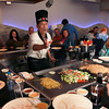 11-13-12<br /> Taku Japanese Steakhouse<br /> Hibachi chef Herman Yuliano entertains a table of Sycamore Elementary employees at Taku Japanese Steakhouse.<br /> KT photo | Kelly Lafferty