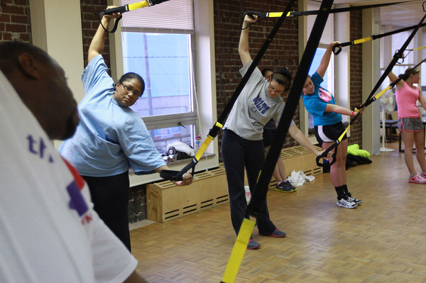 11-15-12<br /> Heartland-TRX class<br /> The TRX class watches instructor Zo Smith as they begin exercising.<br /> KT photo | Kelly Lafferty