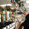 12-10-13<br /> Different assortments of chocolate are on display at J. Edwards Fine Chocolates in Kokomo.<br /> Jennie Miller examines chocolate at J. Edwards in Kokomo.<br /> KT photo | Kelly Lafferty