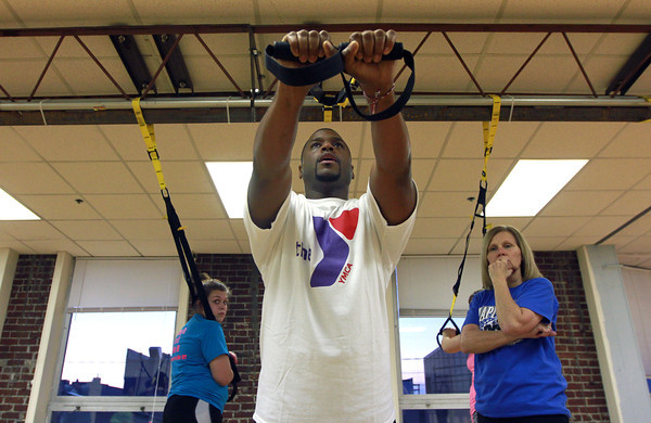 11-15-12<br /> Heartland-TRX class<br /> Instructor Zo Smith demonstrates to the TRX fitness class one of the moves to work the arms.<br /> KT photo | Kelly Lafferty