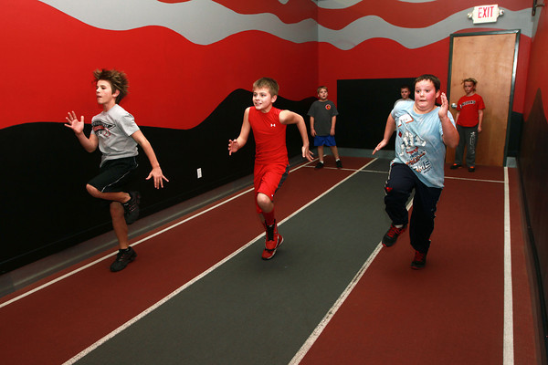 11-28-12<br /> Parisi Speed School at Club Fitness 24<br /> Kitchel Gifford, Reis Coy, and Alex Johnson take off down the track during the Parisi Speed School class.<br /> KT photo | Kelly Lafferty