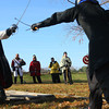 11-17-12<br /> The medeaval reenactment group Empire of Chivalry and Steel campout and battles.<br /> A jousting competition on rafters between Lord Sir Christoph Uuhselin(Justin Ashcroft) and Raphiel Andres(Sean Winegardner). The object was to not be killed by sword or by falling off he wood.<br /> KT photo | Tim Bath