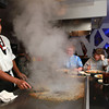 11-13-12<br /> Taku Japanese Steakhouse<br /> Hibachi chef Ketut Teglog cleans off a grill after preparing food at Taku Japanese Steakhouse.<br /> KT photo | Kelly Lafferty