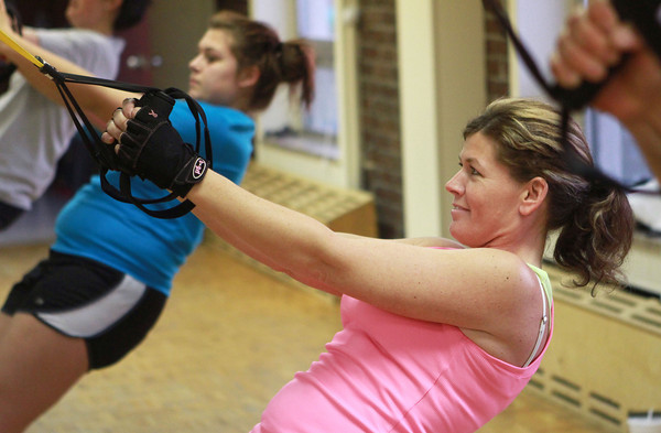11-15-12<br /> Heartland-TRX class<br /> Stephanie Brooks works out during the TRX class at the YMCA.<br /> KT photo | Kelly Lafferty
