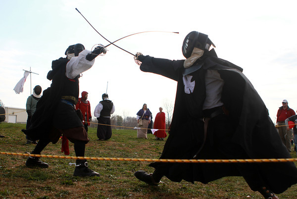 11-10-12<br /> Empire of Chivalry and Steel<br /> Justin Ashcraft (left), who is known as Lord Sir Christoph in the Empire of Chivalry and Steel, has a medeival fight with Nicholas Losekamp, who is also known as Sir William Black, during TechKnow Fest.<br /> KT photo | Kelly Lafferty