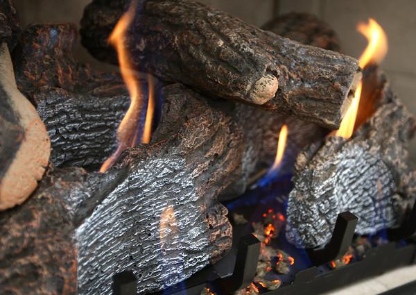 12-7-13<br /> Heartland-Fireplace insert Schlemmer Bros.<br /> Schlemmer Brother's gas insert for a fireplace.<br /> KT photo | Kelly Lafferty