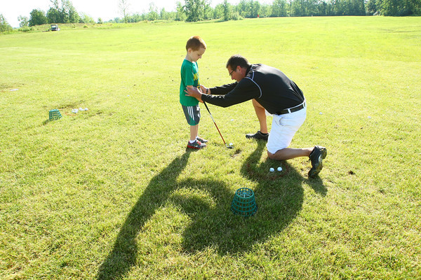 6-4-13<br /> Lessons at Golf Hollow<br /> Blake Wynkoop, 6, getting instruction from Brian Rice.<br /> KT photo | Tim Bath