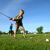 6-4-13<br /> Lessons at Golf Hollow<br /> Landon Crowe, 6, chipping balls.<br /> KT photo | Tim Bath