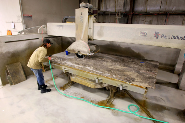 2-5-13     Marble Uniques in Tipton<br /> Allen Mouser cutting a big slab of stone.<br /> KT photo | Tim Bath