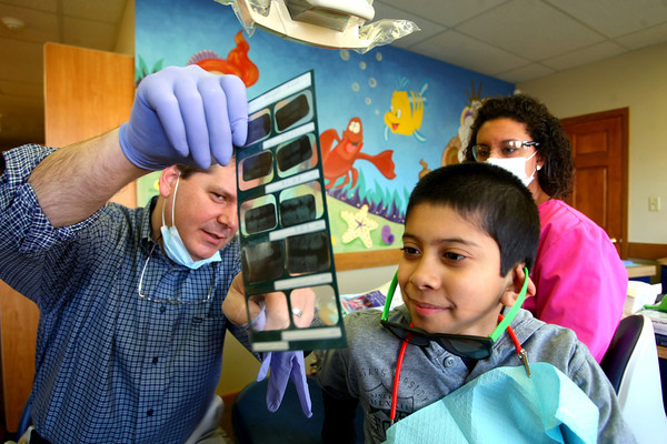 2-6-13      Pediatric Dental Specialists of Indiana PC<br /> Pediatric dental specialists Dr. Matthew Pate and Dr. Robert Long dental practice.  Dr. Long shows ten year-old David Trujillo his xray pointing out a filling.<br /> KT photo   Tim Bath