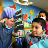2-6-13      Pediatric Dental Specialists of Indiana PC<br /> Pediatric dental specialists Dr. Matthew Pate and Dr. Robert Long dental practice.  Dr. Long shows ten year-old David Trujillo his xray pointing out a filling.<br /> KT photo | Tim Bath