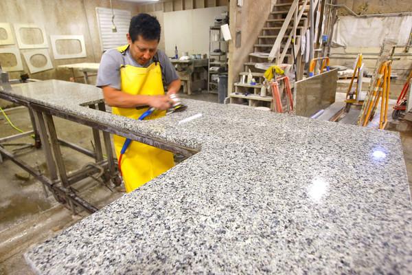 2-5-13     Marble Uniques in Tipton<br /> Pedro Pantoja polishing a granite countertop.<br /> KT photo | Tim Bath
