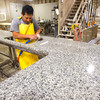 2-5-13     Marble Uniques in Tipton<br /> Pedro Pantoja polishing a granite countertop.<br /> KT photo | Tim Bath