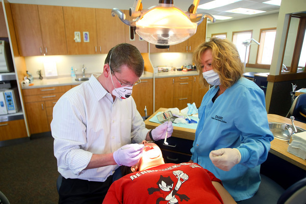 2-6-13       Pediatric Dental Specialists of Indiana PC<br /> Pediatric dental specialists Dr. Matthew Pate and Dr. Robert Long dental practice.  Dr. Pate and Diana Sullivan check out the mouth of Mary Lantz, 15, of Logansport.<br /> KT photo | Tim Bath