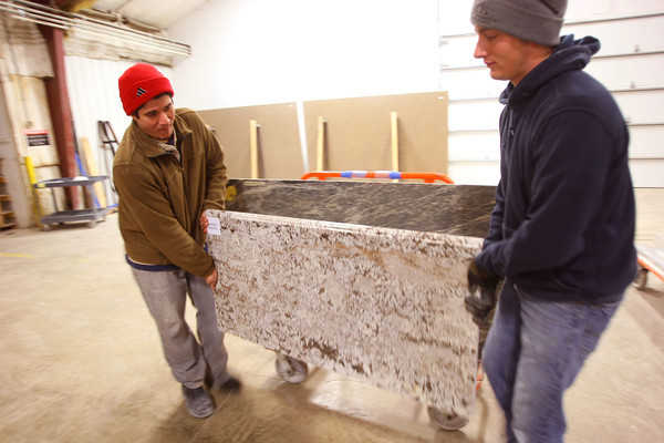 2-5-13     Marble Uniques in Tipton<br /> Justin Coston and Casey LeMay move a finished piece.<br /> KT photo   Tim Bath