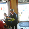 3-28-13<br /> Main Street Cafe owned by Sandra Young at the corner of Main and Mulberry Streets.<br /> Linda Whitesell delivering food to a table.<br /> KT photo | Tim Bath