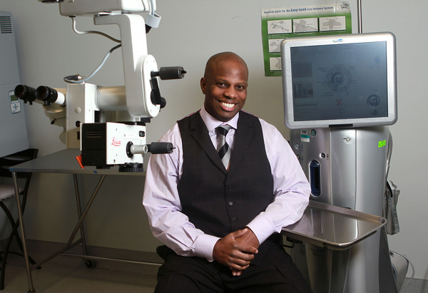 4-4-13<br /> Dr. Kuumba Long, M.D., F.A.A.O, F.A.C.S of Kokomo's Cataract and Laser Institute, sits between the Leica miscroscope and the Bausch and Lomb Stellaris, cataract remover.<br /> KT photo | Kelly Lafferty