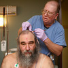 4-3-14<br /> Sleep disorders<br /> Mark Watkins, RPSGT, marks John Fivecoate's head with reference points that distinguishes different parts of the brain, that way, Fivecoate's sleeping habits will be monitored as he undergoes a sleep study at St. Joseph Sleep Center for his sleep apnea.<br /> KT photo | Kelly Lafferty