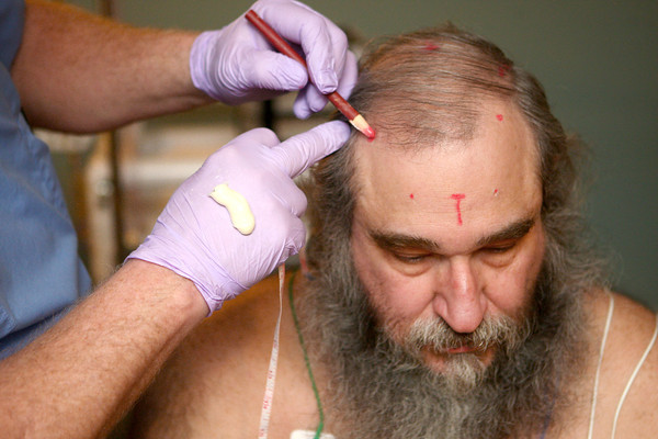 4-3-14<br /> Sleep disorders<br /> John Fivecoate gets reference points on his skull marked at St. Joseph Sleep Center. His brain waves will be monitored during the different stages of his sleep to help find a solution for Fivecoate's sleep apnea.<br /> KT photo | Kelly Lafferty