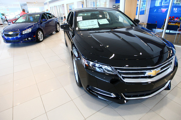 7-19-13<br /> Heartland Magazine Car Technology<br /> The 2014 Chevy Impala (black) and the Chevy Cruze (blue)<br /> KT photo | Kelly Lafferty