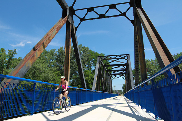 7-23-13<br /> Nickel Plate trail<br /> A woman bikes on the Nickel Plate trail across the Wabash River from Peru.<br /> KT photo   Kelly Lafferty