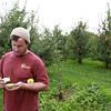 7-26-13<br /> McClure's Orchard<br /> Jason McClure slices an apple in half at McClure's Orchard.<br /> KT photo | Kelly Lafferty