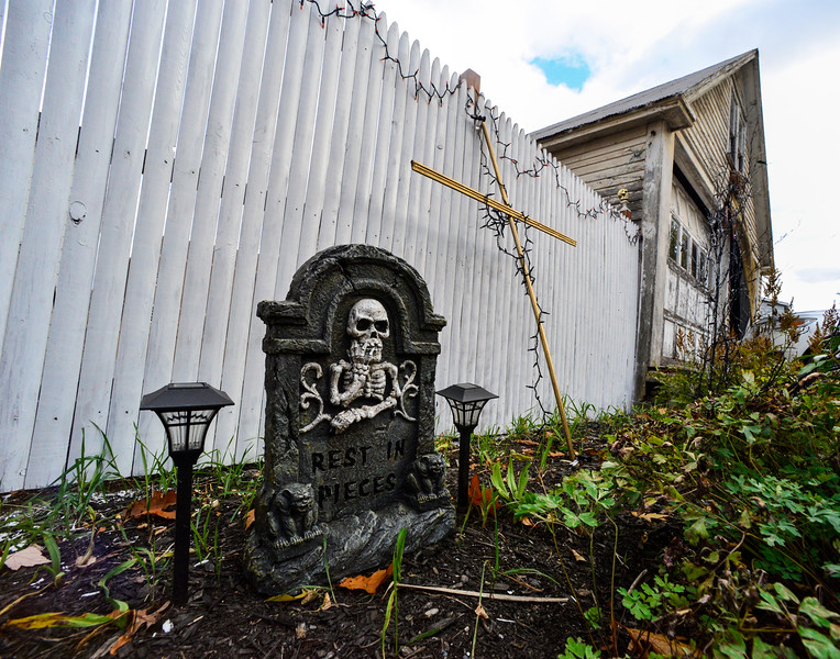 Timothy Wood, of 26 Atwood Street in Brattleboro, Vt., creates a creepy Halloween setting to ring in the day of screams. Kristopher Radder / Reformer Staff