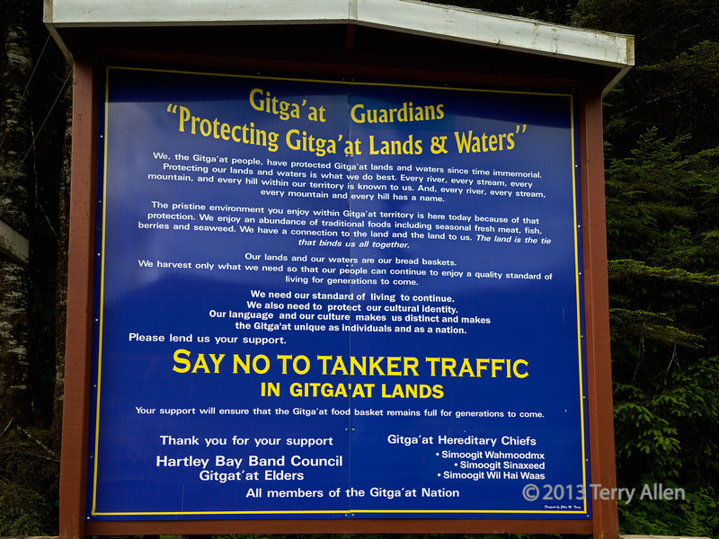 """Sign protesting the plan to build the Northern Gateway pipeline<br /> <br /> The sign, which is a must read at larger sizes, is posted at the seaplane dock at the Gitga'at community of Hartley Bay (Gitag'at are part of the Tsimshian nation).  The proposed Northern Gateway pipeline would bring oil tanker traffic right through the hazardous waters of the highly sensitive ecosystem occupied by the Gitga'at peoples.  Any spill would be impossible to contain and clean up in this environment and would do irreversible damage.<br /> <br /> On March 22, 2006, the BC Ferries vessel 'Queen of the North' ran aground and sank in one hour at the north end of Gil Island, a short distance from Hartley Bay.  The people of Hartley Bay helped rescue 99 of the 101 passengers by quickly driving their fishing and recreational boats to the scene, arriving even before the Canadian Coast Guard. The town community centre was turned into a rescue center with everyone providing food and shelter to the rescued ferry passengers. The town's populace received the Governor General's Commendation for Outstanding Service on May 3, 2006, for """"initiative, selflessness and an extraordinary commitment to the well-being of others""""; the honour also cites the town's """"tremendous spirit and the remarkable example it has set"""". The ferry, with its fuel and its load of 16 passenger cars continues to leak small amounts of fuel into the local area.<br /> <br /> To see other photos of this small aboriginal village with the big heart, see here: <a href=""""http://goo.gl/SnPSkc"""">http://goo.gl/SnPSkc</a><br /> <br /> 8/11/13  <a href=""""http://www.allenfotowild.com"""">http://www.allenfotowild.com</a>"""